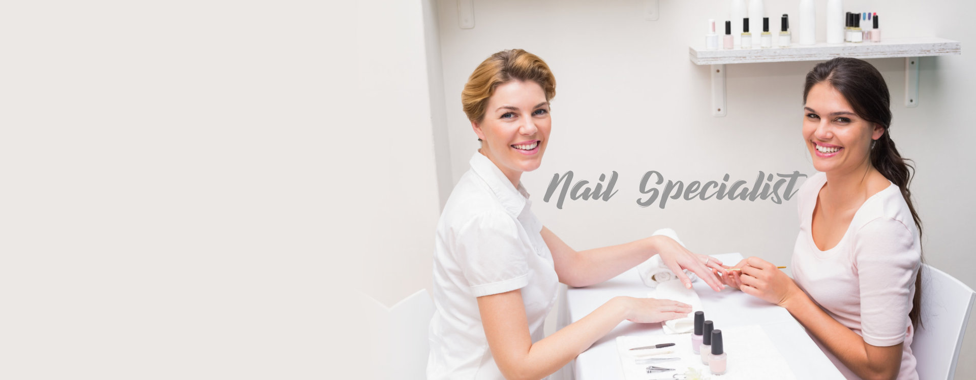 nail specialist taking care of the finger nails of adult woman