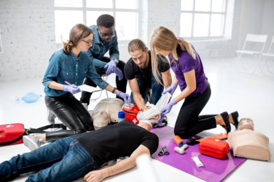 group of people practicing basic life support