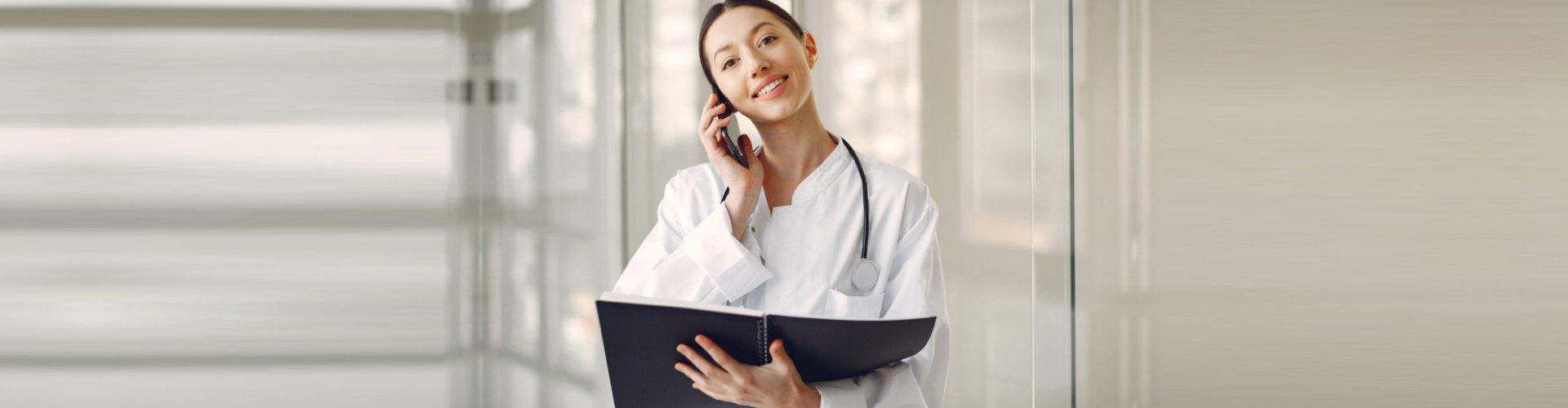 female nurse taking a phone call