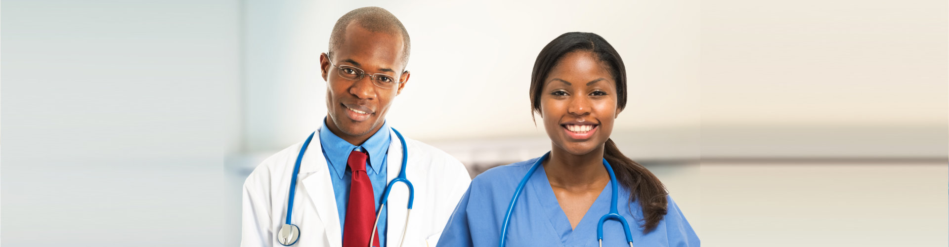 male and female nurse smiling